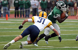 18 October 2014:  Bo Goshorn lunges for runner Anfernee Roberts during an NCAA division 3 football game between the Augustana Vikings and the Illinois Wesleyan Titans in Tucci Stadium on Wilder Field, Bloomington IL