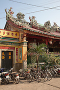 The typical Fujian Ha Chuong Hoi Quan Pagoda  is dedicated to Thien Hau, who was born in Fujian. The four carved stone pillars, wrapped in painted dragons, were made in China and brought to Vietnam by boat. There are interesting murals to each side of the main altar and impressive ceramic relief scenes on the roof.