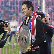 Mike Petke, coach of the New York Red Bulls, with the supporters shield after the New York Red Bulls V Chicago Fire, Major League Soccer regular season match at Red Bull Arena, Harrison, New Jersey. USA. 27th October 2013. Photo Tim Clayton