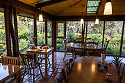 Eat healthy papaya boats and banana bread for breakfast in the dining room overlooking a tree fern forest at Volcano Inn, on the Big Island, Hawaii, USA. Address: 19-3820 Old Volcano Rd, Volcano, HI 96785