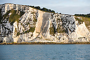 The morning sunlight shines on the famous chalky White Cliffs of Dover above The Warren beach, Folkestone, Kent, England, United Kingdom.  (photo by Andrew Aitchison / In pictures via Getty Images)