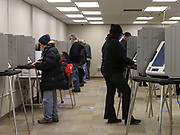 Turnout was steady during the first day of early voting. Machines were spaced out at intervals and regularly sanitized.