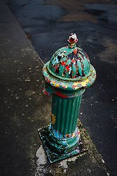 Fire hydrant with layers of peeled paint, Kinvarra, County Galway, Ireland