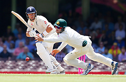 England's Tom Curran plays a shot past Cameron Bancroft during day five of the Ashes Test match at Sydney Cricket Ground.