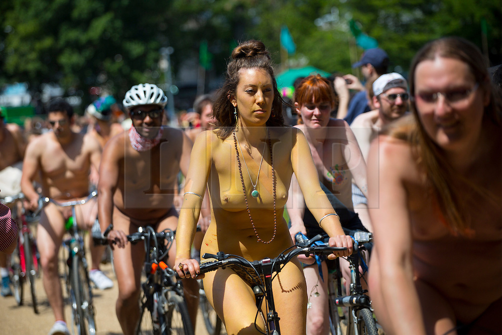 © Licensed to London News Pictures. 08/06/2014. BRIGHTON, UK. Nude protesters cycling through the streets of Brighton on Sunday 8 June 2014 as part of the World Naked Bike Ride, which aims to raise awareness of cyclists on the roads and in the traffic. Photo credit : Tolga Akmen/LNP