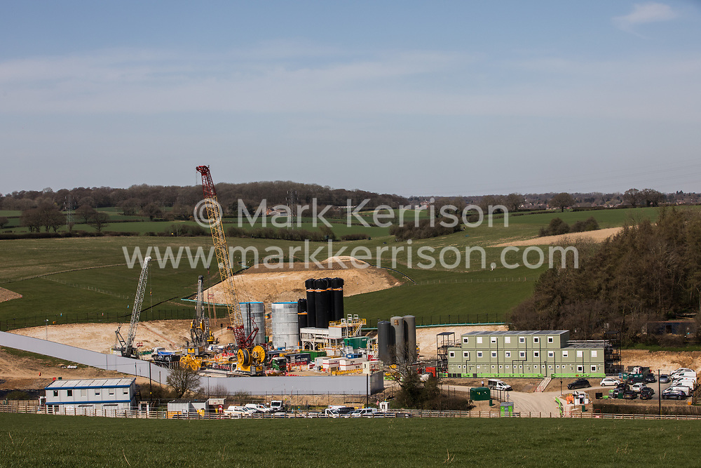 Chalfont St Giles, UK. 30 March, 2021. A general view of a construction compound for works on a ventilation shaft for the Chiltern Tunnel section of the HS2 high-speed rail link. The works, off Bottom House Farm Lane, include the construction of a temporary haul road and an embankment as well as the ventilation shaft.