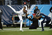 Jacksonville Jaguars wide receiver Dede Westbrook (12) high steps it as he catches a pass while defended by Tennessee Titans cornerback Malcolm Butler (21) during the week 14 regular season NFL football game against the Tennessee Titans on Thursday, Dec. 6, 2018 in Nashville, Tenn. The Titans won the game 30-9. (©Paul Anthony Spinelli)