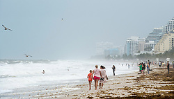 People walk along the ocean as winds pick up in anticipation for Hurricane Irma Saturday, September 9, 2017 in Fort Lauderdale, FL, USA. Photo by Paul Chiasson/CP/ABACAPRESS.COM