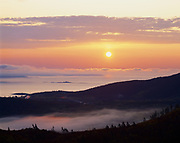 Sunrise over Frenchman Bay with Egg Rock and the Schoodic Peninsula, slope of Cadillac Mountain, Mount Desert Island, Acadia National Park, Maine.