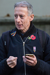 London, UK. 10 November, 2019. Human rights campaigner Peter Tatchell watches ex-services personnel from Veterans For Peace UK (VFP UK) taking part in the Remembrance Sunday ceremony at the Cenotaph. VFP UK was founded in 2011 and works to influence the foreign and defence policy of the UK for the larger purpose of world peace.