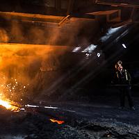 BRITISH STEEL - Scunthorpe - Heavy End - Iron & Steel Production Steel worker under the Blast Furnace