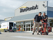 Image of Herc Rental Company Employees working outside a Miami Location. The image was shot for the Herc 2017 Annual Report