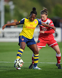 Arsenal Ladies' Danielle Carter competes with Bristol Academy's Loren Dykes - Photo mandatory by-line: Paul Knight/JMP - Mobile: 07966 386802 - 09/05/2015 - SPORT - Football - Bristol - Stoke Gifford Stadium - Bristol Academy Women v Arsenal Ladies FC - FA Women's Super League