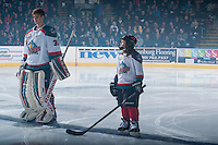KELOWNA, CANADA - FEBRUARY 9: The Pepsi Save On Foods player of the game lines up beside Jake Morrissey #31 of Kelowna Rockets against the Prince George Cougars on February 9, 2015 at Prospera Place in Kelowna, British Columbia, Canada.  (Photo by Marissa Baecker/Shoot the Breeze)  *** Local Caption *** Jake Morrissey; Pepsi Save On Foods Player;