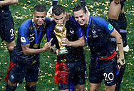 Kylian Mbappe, Lucas Hernandez, Florian Thauvin of France celebrate with the trophy after winning the 2018 FIFA World Cup Russia, final football match between France and Croatia on July 15, 2018 at Luzhniki Stadium in Moscow, Russia - Photo Tarso Sarraf / FramePhoto / ProSportsImages / DPPI
