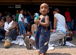 31st August, 2005. 'Hell on earth.' The Superdome in New Orleans, Louisiana where over 20,000 refugees from hurricane Katrina are crammed into hellish conditions. A lone child wanders amidst the masses in the Superdome.