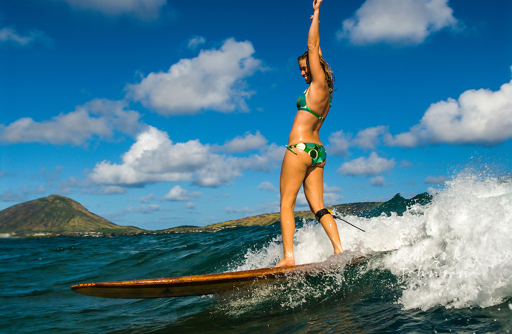 Happy Woman Surfer, arms raised, Oahu, Hawaii ***Model Release available