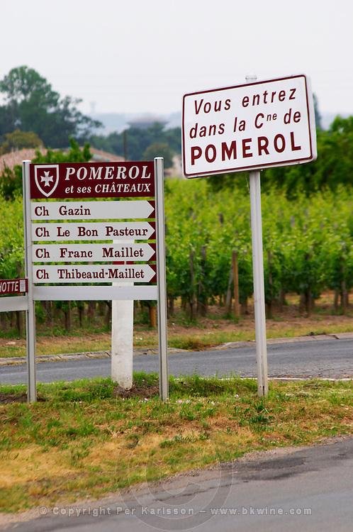 Road sign saying 'Vous entrez dans la commune de Pomerol' (you are entering the commune of Pomerol) and signs pointing to Chateau Gazin, Le Bon Pasteur, Franc Maillet, Thibeaud-Maillet Pomerol Bordeaux Gironde Aquitaine France