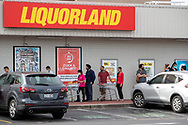 People line up outside Liquorland at Kurralta Park. New COVID Lockdown Restrictions announced today by the SA Premier Steven Marshall caused panic shopping at supermarkets as people stocked up with essential groceries.   (Photo by Peter Mundy/Speed Media)