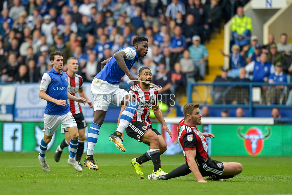 Sheffield Wednesday forward Lucas Joao (18)  scores a goal to make it 2-2 during the EFL Sky Bet Championship match between Sheffield Wednesday and Sheffield Utd at Hillsborough, Sheffield, England on 24 September 2017. Photo by Adam Rivers.