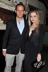 DAISY DE VILLENEUVE and FINN CACKETT at a party tocelebrate the launch of Diesel's new female fragrance 'Loverdose' held at The Box, 11-12 Walkers Court, Brewer Street, London on 7th September 2011.