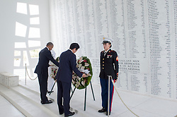 U.S. President Barack Obama (left) and Japanese Prime Minister Shinzo Abe present wreaths at the USS Arizona Memorial to honor the service members killed during the Dec. 7, 1941 attacks on Pearl Harbor, in Honolulu, USA, on December 27, 2016. Abe is the first Japanese prime minister to visit the USS Arizona Memorial. Photo by DOD via Balkis Press/ABACAPRESS.COM