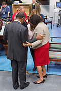 Retired Neurosurgeon and Republican presidential candidate Dr. Ben Carson and wife Candy pray for the patients during a visit to the MUSC Children's Hospital December 22, 2015 in Charleston, South Carolina. Carson stopped by to listen to Christmas carols and greet the young patients.