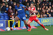 AFC Wimbledon attacker Michael Folivi (41) battles for possession with Doncaster Rovers midfielder James Coppinger (26) during the EFL Sky Bet League 1 match between AFC Wimbledon and Doncaster Rovers at the Cherry Red Records Stadium, Kingston, England on 9 March 2019.