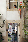 Entrance of a house at the Alfama district, on the way of Lisbon's nº28 yellow tram, through the central, most historic region of the city.