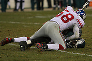 PHILADELPHIA - DECEMBER 9: Reggie Brown of the Philadelphia Eagles is pinned by Antonio Pierce #58 of the New York Giants during the game on December 9, 2007 at Lincoln Financial Field in Philadelphia, Pennsylvania. The Giants won 16-13.
