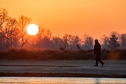 © Licensed to London News Pictures. 12/12/2017. London, UK. Sunrise in Bushy park, south-west London this morning. The park experienced a frost as temperatures in the area dropped to -3 overnight. Large areas of the UK have experienced a cold weather snap with frost and snow over the past 3 days. Photo credit : Tom Nicholson/LNP