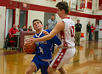 Inter Lakes' Davis Jollimore gets pressure from Laconia's Ryan Paiva during NHIAA Division III basketball Tuesday evening.  (Karen Bobotas/for the Laconia Daily Sun)