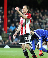 Brentford striker Lasse Vibe after missing a golden chance to put Brentford ahead during the Sky Bet Championship match between Brentford and Middlesbrough at Griffin Park, London, England on 12 January 2016. Photo by Matthew Redman.