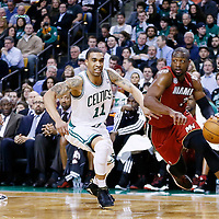 18 March 2013: Miami Heat shooting guard Dwyane Wade (3) drives past Boston Celtics shooting guard Courtney Lee (11) during the Miami Heat 105-103 victory over the Boston Celtics at the TD Garden, Boston, Massachusetts, USA.