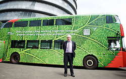 Boris Johnson Mayor of London launches world-first electric double-decker bus trial at global Clean Bus Summit<br /> <br />  <br /> <br /> 29th June 2015<br /> at City Hall, London, Great Britain <br /> <br /> Boris Johnson<br /> <br /> and hybrid double-decker bus wrapped in green livery<br /> <br /> <br /> The Mayor of London Boris Johnson will announce that London is set to trial the world's first purpose-built double-decker purely electric bus, during the first ever global Clean Bus Summit. The Summit is organised with C40, a partnership of global cities acting on climate change, at City Hall. <br /> <br /> <br /> <br /> Photograph by Elliott Franks <br /> Image licensed to Elliott Franks Photography Services