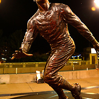 A small floral display rests at the feet of the statue of Roberto Clemente outside of PNC Park in Pittsburgh to celebrate Robert Clemente Day on Wednesday, September 9, 2020.  Every Pittsburgh Pirates wore the number 21 to honor Hall of Fame outfielder Roberto Clemente during their 8-1 lost to the Chicago White Sox.  Photo by Archie Carpenter/UPI