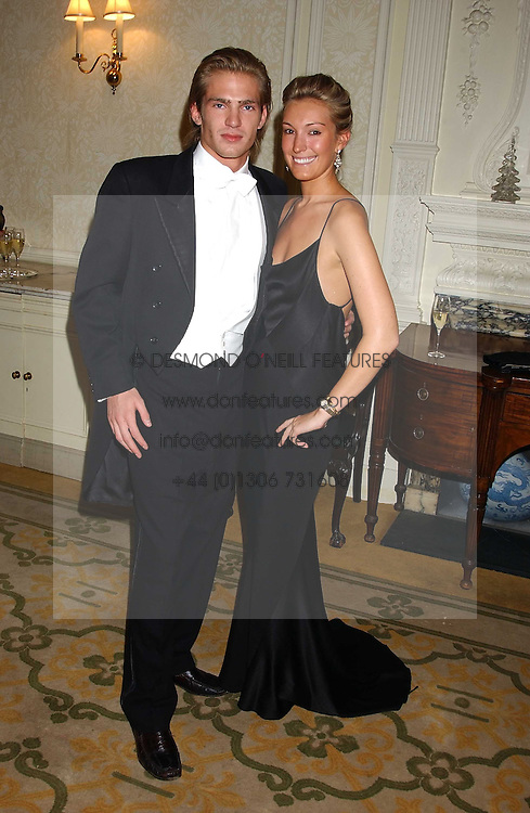 MR JACOBI ANSTRUTHER-GOUGH-CALTHORPE and MISS OLIVIA BUCKINGHAM at a dinner hosed by Moet & Chandon at their headquarters at 13 Grosvenor Crescent, London on 12th October 2005.<br /><br />NON EXCLUSIVE - WORLD RIGHTS