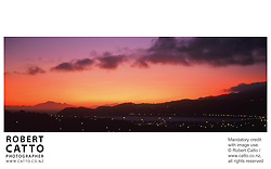 A panoramic sunset view over Lyall Bay, Wellington, New Zealand.