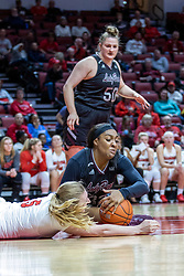 NORMAL, IL - February 27: Emily Gartner watches Lexy Koudelka and Jasmine Franklin scrap for a loose ball on the floor during a college women's basketball game between the ISU Redbirds and the Bears of Missouri State February 27 2020 at Redbird Arena in Normal, IL. (Photo by Alan Look)
