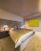 Elegant bedroom in designer apartment. Nobody inside