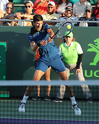 March 22, 2018 - Key Biscayne, Florida, United States Of America - KEY BISCAYNE, FL - MARCH 22: Novak Djokovic during Day 4 of the Miami Open at the Crandon Park Tennis Center on March 22, 2018 in Key Biscayne, Florida...People:  Novak Djokovic. (Credit Image: © SMG via ZUMA Wire)