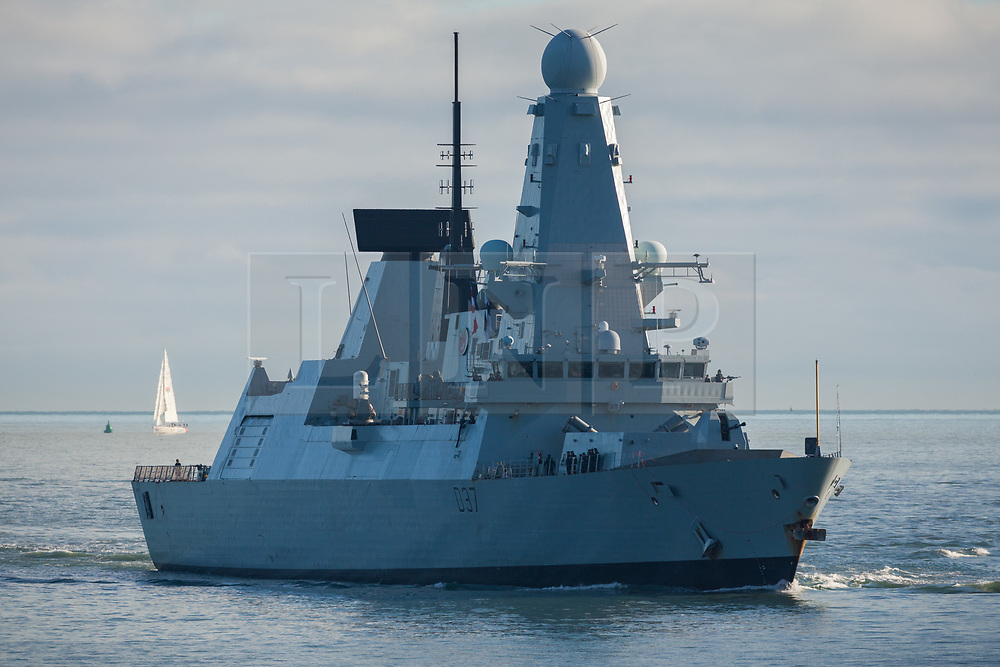 © Licensed to London News Pictures. 25/10/2017. Portsmouth, UK.  HMS Duncan (D37) approaching the entrance to Portsmouth Harbour today, 25th October 2017. The Type 45 destroyer has been in Portsmouth since September and is believed to be preparing to resume the role as flagship to the Standing NATO Maritime Group 2 (SNMG2) in the Mediterranean Sea, currently being fulfilled by HMS Diamond.  Photo credit: Rob Arnold/LNP