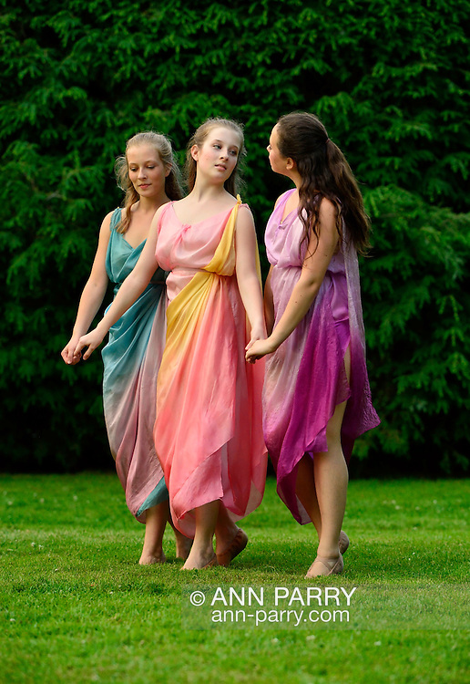Old Westbury, New York, U.S. 22nd June 2013. Dances by Lori Belilove & The Isadora Duncan Dance Company, with appearances by the Beliloveables, are performed by dancers at the Midsummer Night event at Old Westbury Gardens, throughout the illuminated grounds of the historic Long Island Gold Coast estate.<br />