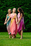 Old Westbury, New York, U.S. 22nd June 2013. Dances by Lori Belilove & The Isadora Duncan Dance Company, with appearances by the Beliloveables, are performed by dancers at the Midsummer Night event at Old Westbury Gardens, throughout the illuminated grounds of the historic Long Island Gold Coast estate.<br /> The Three Graces, or Three Charities, of Greek mythology were Aglaia, Euphrosyne, and Thalia - goddesses of beauty, joy, harmony, pleasure, grace, festivity, adornment, dance, and song. Daughters of Zeus and sea-nymph Eurynome, they were also the attendants, or handmaidens, of Aphrodite and Hera and protectors of vegetation.