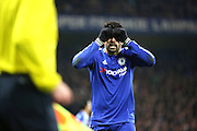 Chelsea striker Diego Costa (19) talking to the linesman during the Champions League match between Chelsea and Paris Saint-Germain at Stamford Bridge, London, England on 9 March 2016. Photo by Matthew Redman.