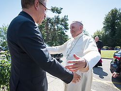 """21 June 2018, Geneva, Switzerland: On 21 June 2018, the World Council of Churches receives a visit from Pope Francis of the Roman Catholic Church. Held under the theme of """"Ecumenical Pilgrimage - Walking, Praying and Working Together"""", the landmark visit is a centrepiece of the ecumenical commemoration of the WCC's 70th anniversary. The visit is only the third by a pope, and the first time that such an occasion was dedicated to visiting the WCC. Here, an ecumenical prayer service with religious leaders from all over the world. Here, Pope Francis is greeted by WCC general secretary Rev. Dr Olav Fykse Tveit as the Pope arrives at the Ecumenical Centre."""