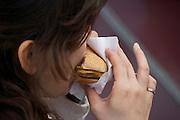 girl biting a hamburger