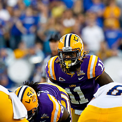 October 16, 2010; Baton Rouge, LA, USA; LSU Tigers linebacker Kelvin Sheppard (11) lines up against the McNeese State Cowboys during a game at Tiger Stadium. LSU defeated McNeese State 32-10. Mandatory Credit: Derick E. Hingle