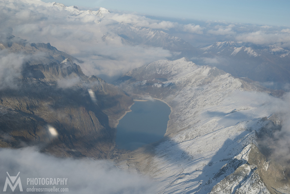 Aerial view of an artificial lake in the Swiss alps.