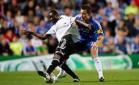 Photo: Richard Lane/Sportsbeat Images.<br />Chelsea v Rosenborg. UEFA Champions League Group B. 18/09/2007. <br />Rosenborg's Traore is challenged by Chelsea's John Terry.